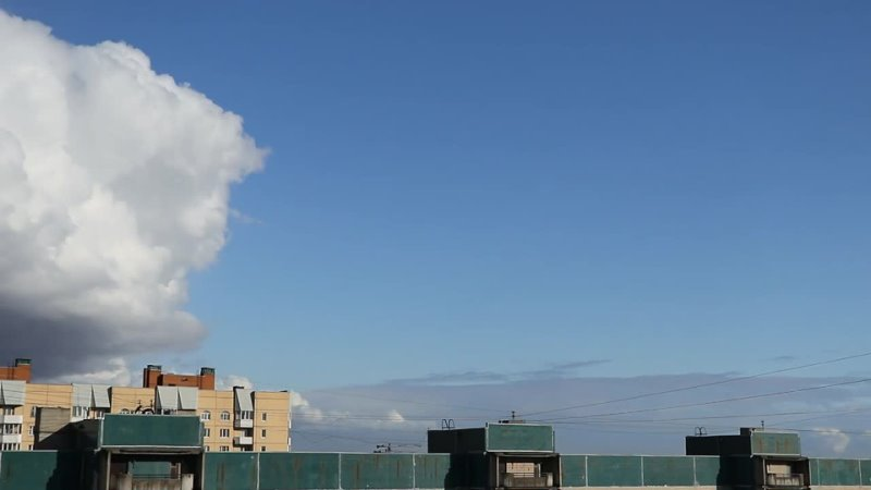 Clouds gather over residential buildings in the sleeping area. Day time lapse.