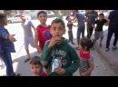 Y2mate - Palestinian kids celebrate Eid alFitr amid destruction_1080p