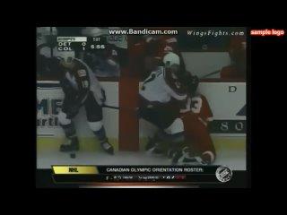 Claude Lemieux hits Kris Draper in the 1996 playoffs