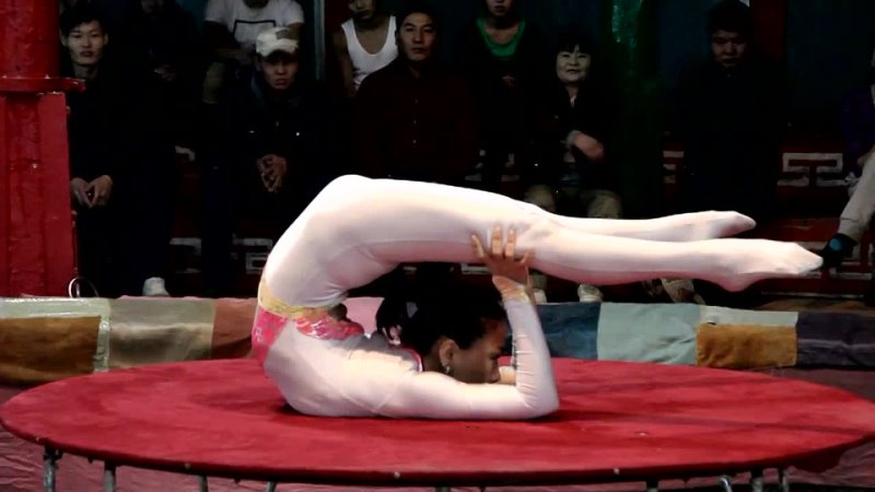 Mongolian Contortionist In White Unitard