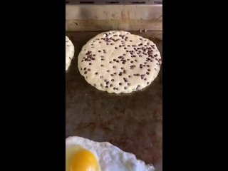 Flipping pancakes and eggs.