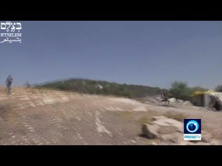 Watch: Settler opens fire at Palestinians with Israeli soldier's rifle