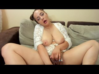 A girl with good breasts and ass caresses her pussy