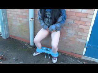 Naughty_and_horny_strips_and_pisses_in_the_middle_of_the_street_in_front